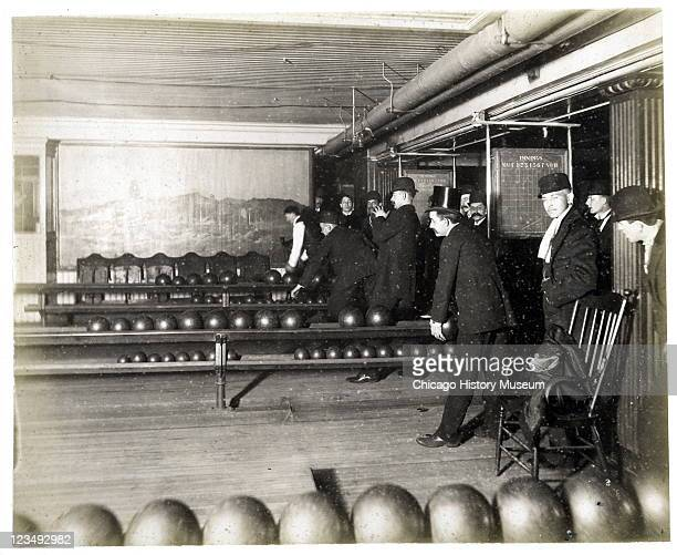 View of men bowling in the bowling alleys at a Hannah and Hogg location at 83 Madison Street Chicago IL 1889