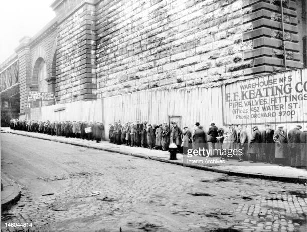 View of men queuing up for a bread line near the Brooklyn Bridge New York 1930s Farm Security Administration