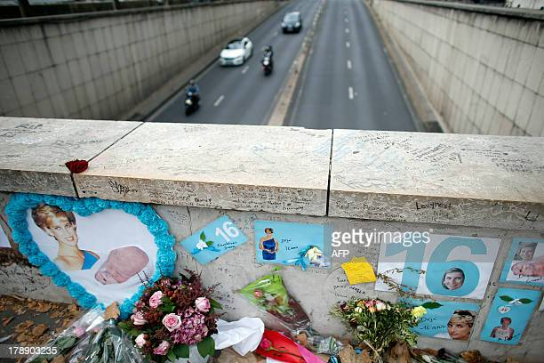 View of messages and flowers left for Britain's late Princess Diana on the Pont de l'Alma in Paris on August 31 2013 on the 16th anniversary of the...
