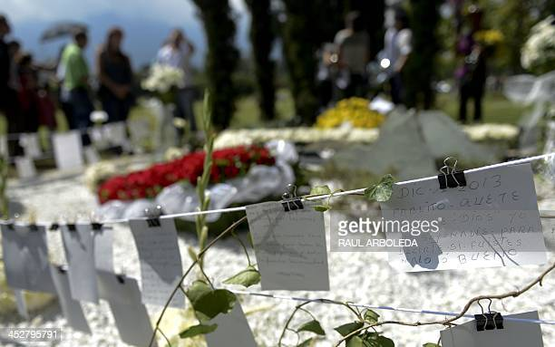 View of messages left by Colombian drug lord Pablo Escobar's tomb at Montesacro cemetery in Medellin Antioquia department Colombia on December 1 a...