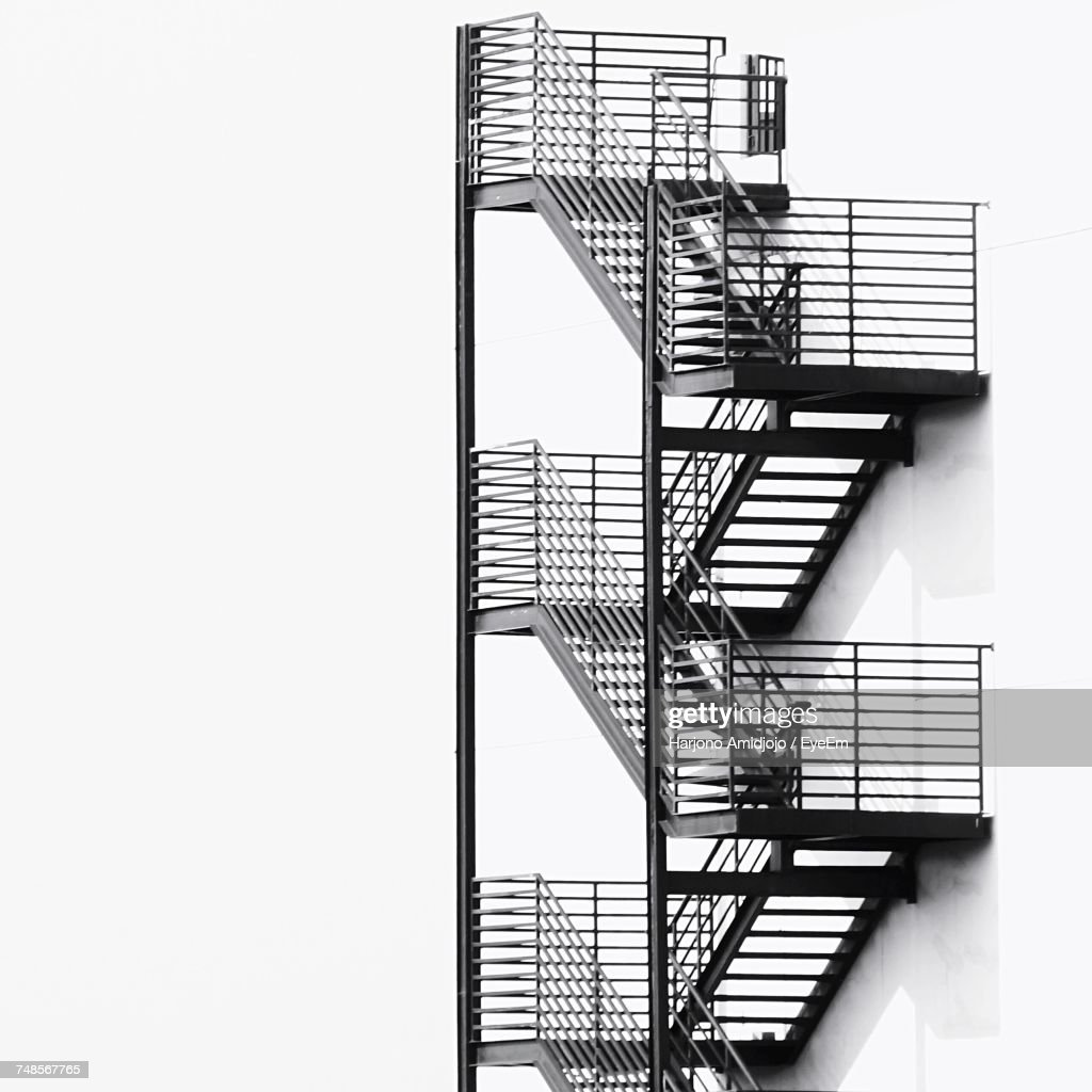View Of Metallic Fire Escape By Buildings