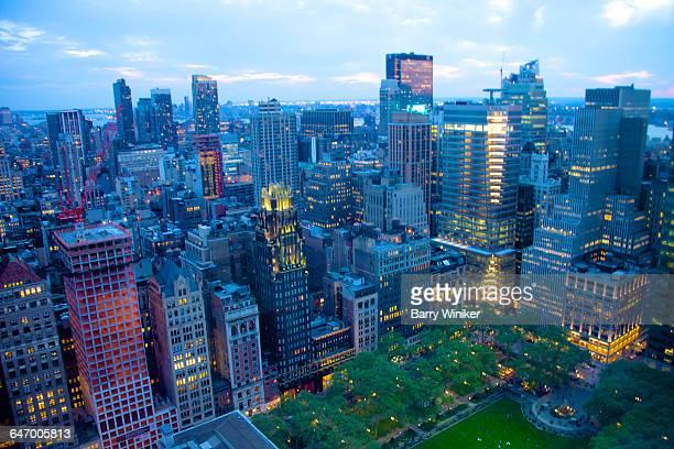 view of midtown manhattan at night - ブライアント公園 ストックフォトと画像