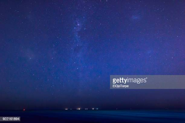 view of milky way from montevideo's coastline, uruguay - south stock pictures, royalty-free photos & images