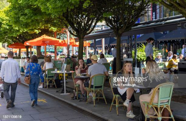 View of Mill Lane as people drink and dine out in sunny weather on June 01, 2021 in Cardiff, Wales. 2 274 people in Wales have now had their first...