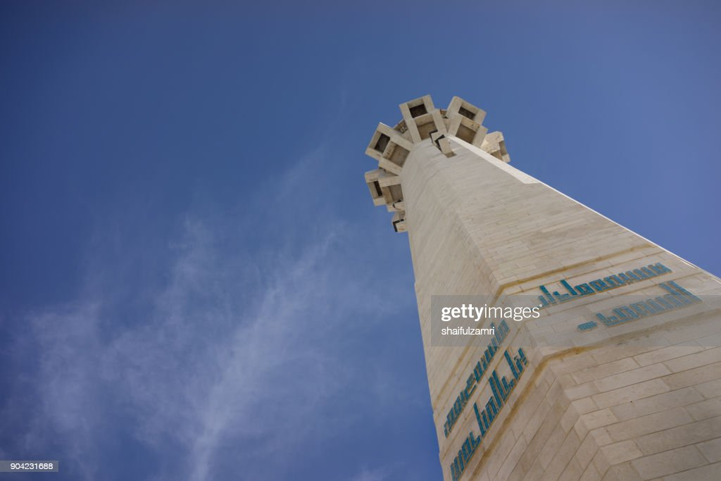 View of minaret for The King Abdullah I Mosque in Amman, was opened in 1989. It's capped by a magnificent blue mosaic dome beneath which 3,000 Muslims may offer prayer. : Stock Photo