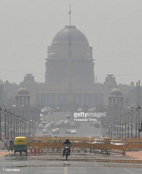 A view of mirage seen on the Rajpath as temperature soars high on April 24 2019 in New Delhi India Delhis Ridge Observatory recorded highest maximum...