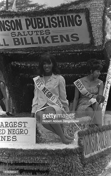 View of Miss Negro Digest and others as they ride the Johnson Publishing float during the Bud Billiken Day parade Chicago Illinois mid to late 1960s