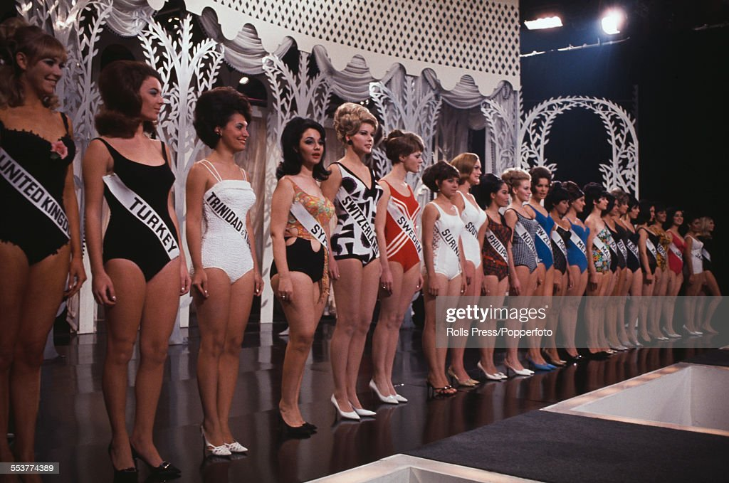 View of Miss World beauty pagent finalists from various countries, all dressed in bathing costumes, lining up to be judged on the stage of the Lyceum Ballroom in London on 17th November 1966. The eventual winner of the pageant would be Reita Faria of India.