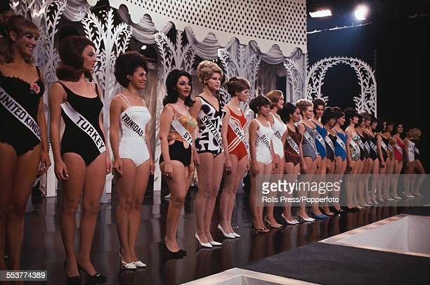 View of Miss World beauty pagent finalists from various countries, all dressed in bathing costumes, lining up to be judged on the stage of the Lyceum...