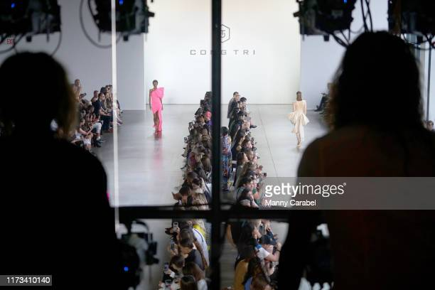 View of models walking the runway in Gallery II from the Skybox Lounge at Spring Studios during New York Fashion Week: The Shows on September 09,...