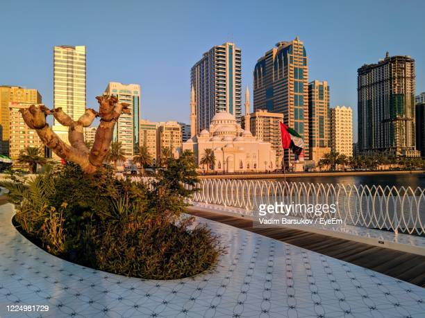 view of modern buildings against clear sky - emirate of sharjah stock pictures, royalty-free photos & images