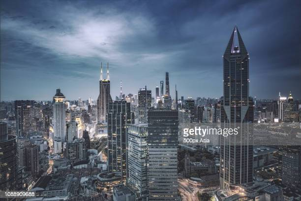 view of modern city at night, shanghai, china - image stockfoto's en -beelden