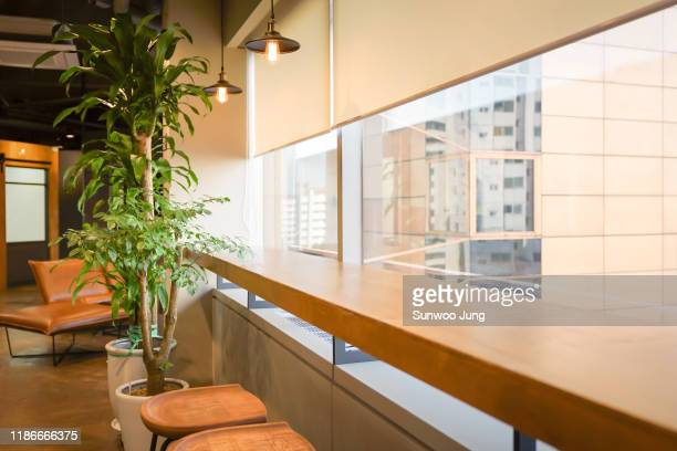 view of modern co-working space - conglomerate stock pictures, royalty-free photos & images