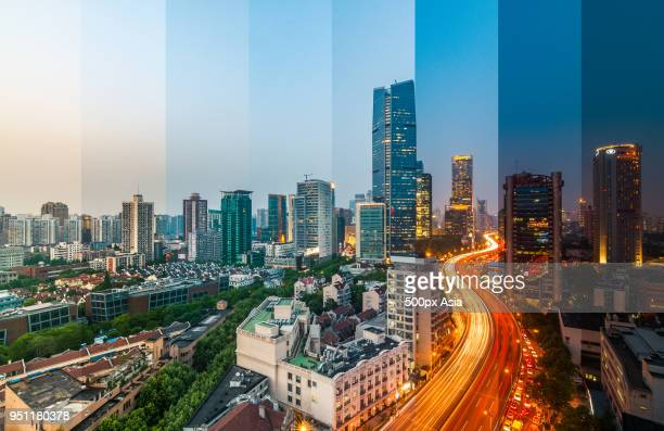 view of modern skyscrapers and road  from day to night - image stock pictures, royalty-free photos & images