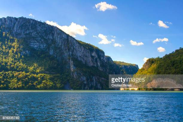 view of monastery by river, la cazane, dubova, romania - danube river stock pictures, royalty-free photos & images
