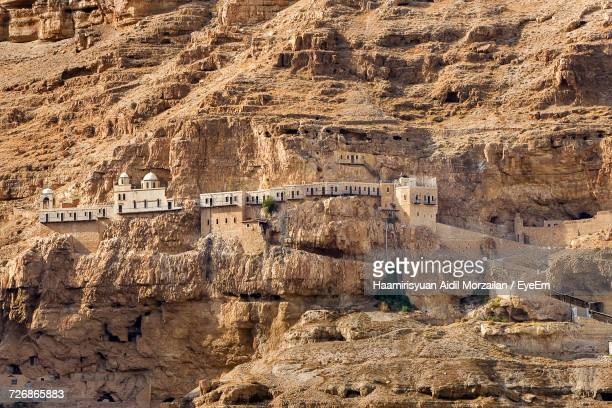 view of monastery of the temptation - jericho stock photos and pictures