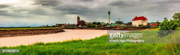 a view of moncton city from petitcodiac river - moncton stock photos and pictures