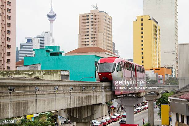 view of monorail and city, kuala lumpur, malaysia - monorail stock pictures, royalty-free photos & images