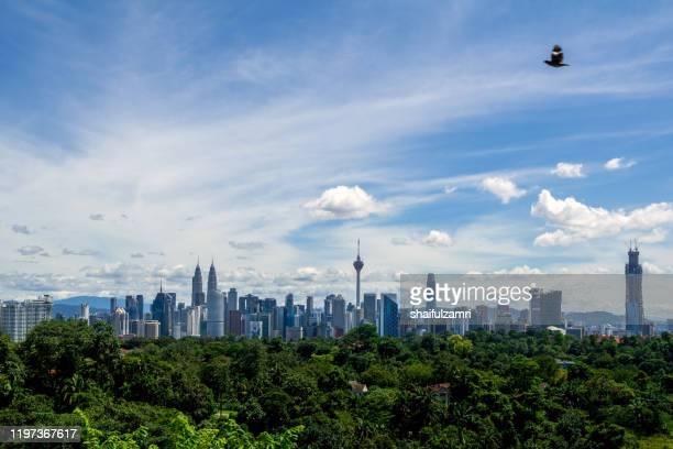view of monsoon clouds over downtown kuala lumpur, malaysia - shaifulzamri imagens e fotografias de stock