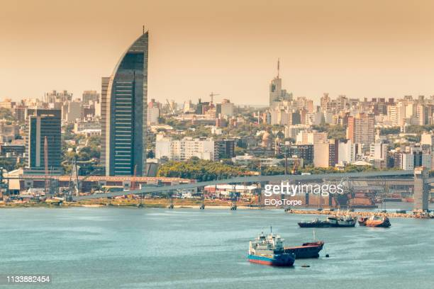 view of montevideo skyline and montevideo port, uruguay - montevideo stock pictures, royalty-free photos & images