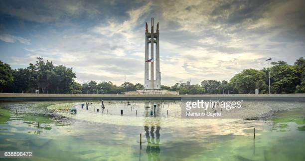 view of monument at the park against cloudy sky - philippines flag stock pictures, royalty-free photos & images