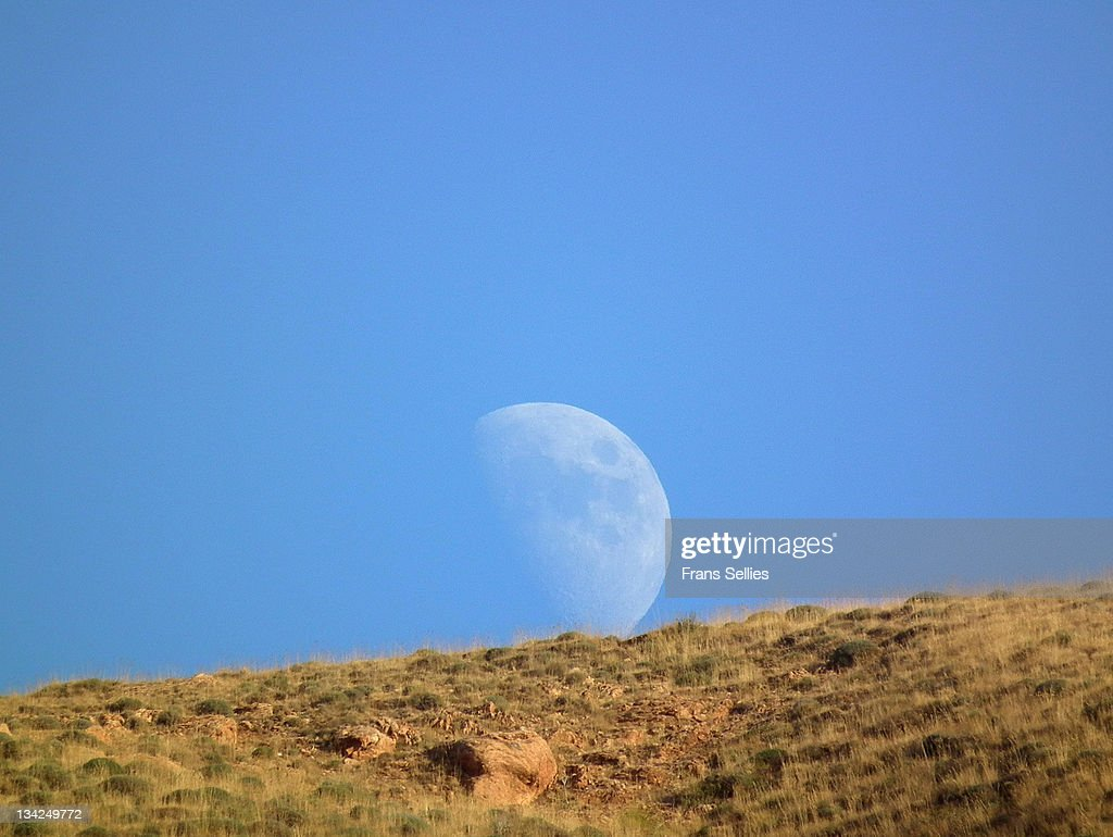 View of moon over mountain : Stockfoto