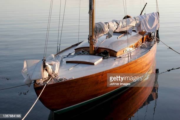 view of moored wooden sailing boat - moored stock pictures, royalty-free photos & images