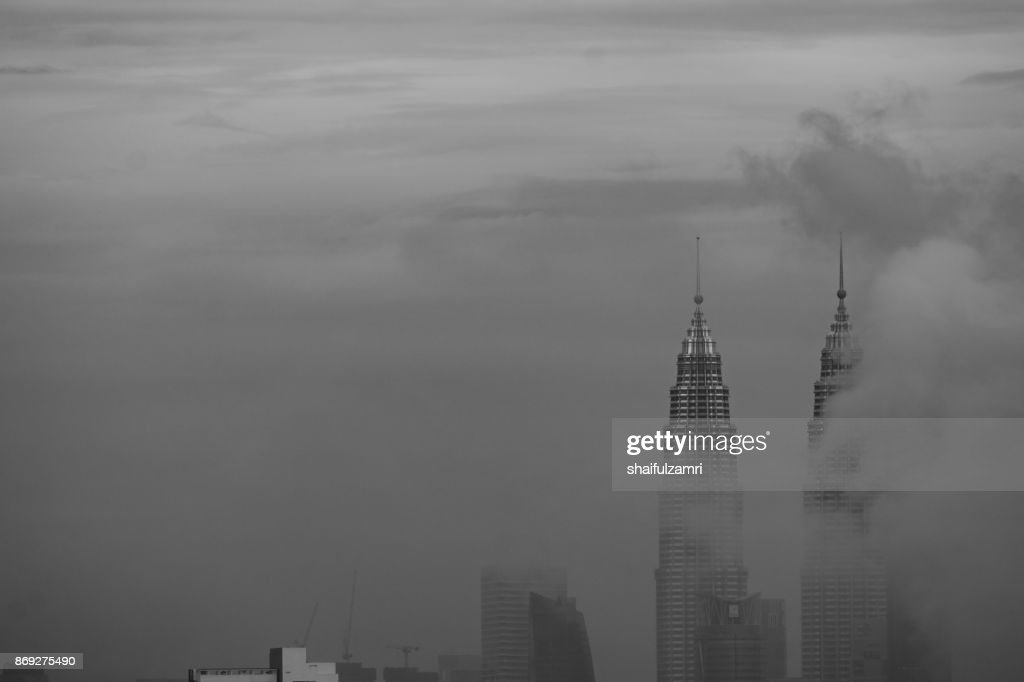 View of morning fog over Petronas Twin Towers in downtown Kuala Lumpur, Malaysia : Stock Photo
