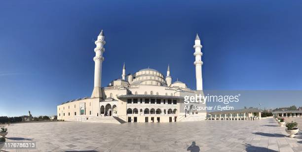 view of mosque against blue sky - cankaya district ankara stock pictures, royalty-free photos & images