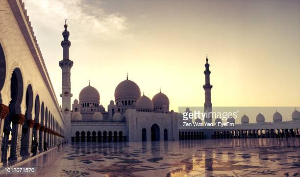 view of mosque against sky during sunset - mosque stock pictures, royalty-free photos & images