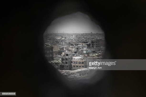 A view of Mosul's Old City through an Iraqi forces sniper hole in the wall of a frontline position in Adedat a neighbourhood in the Old City of west...