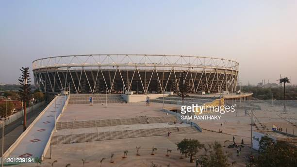 A view of Motera Cricket Stadium is pictured on the outskirts of Ahmedabad on February 16 2020 A barbed wire topped wall that will hide Donald...