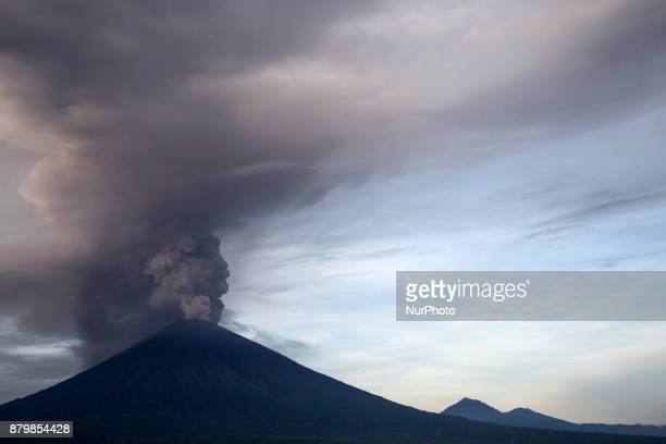 View of Mount Agung Volcano Erupted in the morning from Amed Beach Mount Agung Volcano erupted with giving above 3000 meter of cloud that filled the...