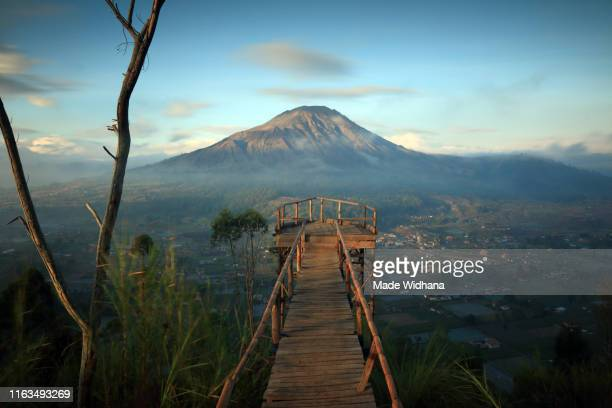 view of mount batur in the early morning - kintamani district stock pictures, royalty-free photos & images