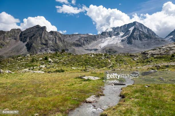 a view of mount collalto - hochgall with its glacier, parco naturale vedrette di ries - aurina, south tyrol, south tyrol - rock formation stock pictures, royalty-free photos & images