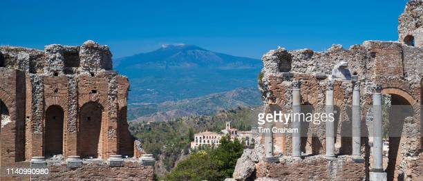 View of Mount Etna volcano from ruins of the ancient Greek Theatre amphitheatre Teatro Greco of Taormina East Sicily Italy