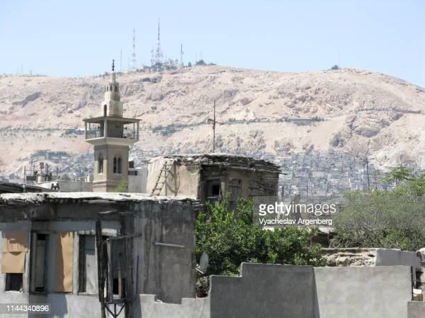 view of mount qasioun from central damascus - argenberg bildbanksfoton och bilder