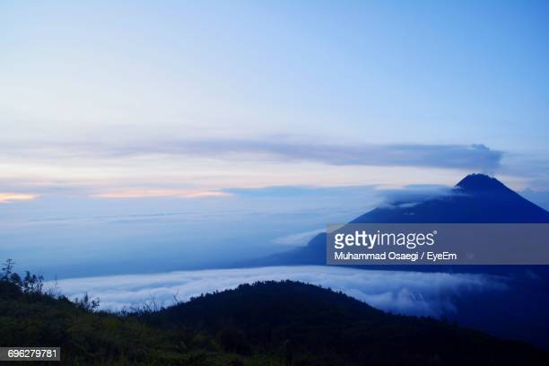 view of mountain against cloudy sky - surakarta stock photos and pictures