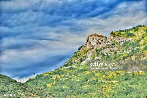 view of mountain against cloudy sky - antonella stock photos and pictures