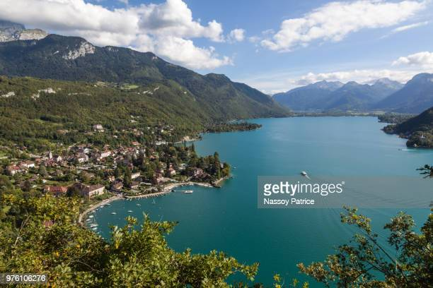 view of mountain lake, talloires, france - lake annecy stock photos and pictures