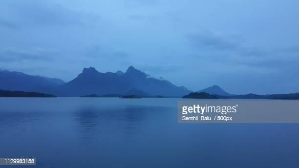 View of mountain range behind lake