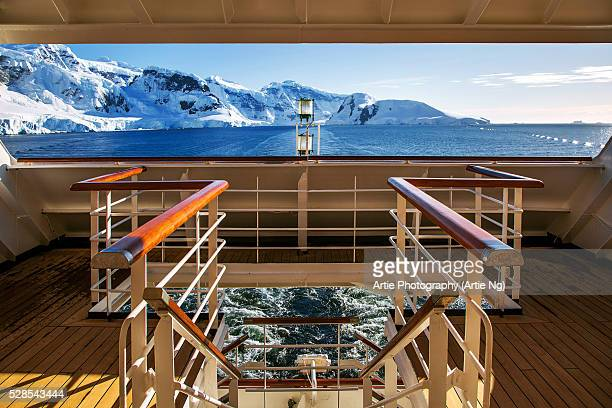 view of mountain ranges at paradise bay from shipdeck, west coast of the antarctic peninsula, antarctica - antarctica stock pictures, royalty-free photos & images