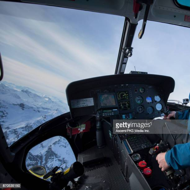 AERIAL view of mountain ranges, from helicopter cockpit
