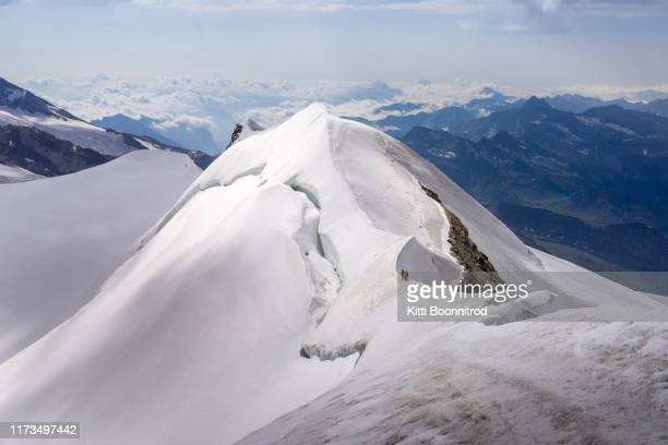 view of mountain ridge from the summit of castor, switzerland - monte rosa foto e immagini stock