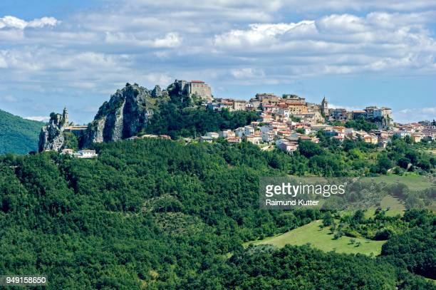 view of mountain village bagnoli del trigno with church chiesa di san silvestro and castle ruin chiesa di san silvestro, bagnoli del trigno, molise, italy - castle mountain stock photos and pictures
