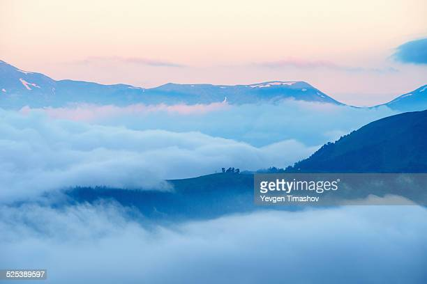 View of mountains above clouds at sunrise, Svaneti, Georgia