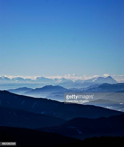 view of mountains against blue sky - 山岳地帯 ストックフォトと画像