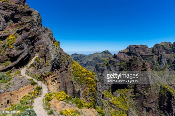 view of mountains against clear blue sky - ilha da madeira imagens e fotografias de stock
