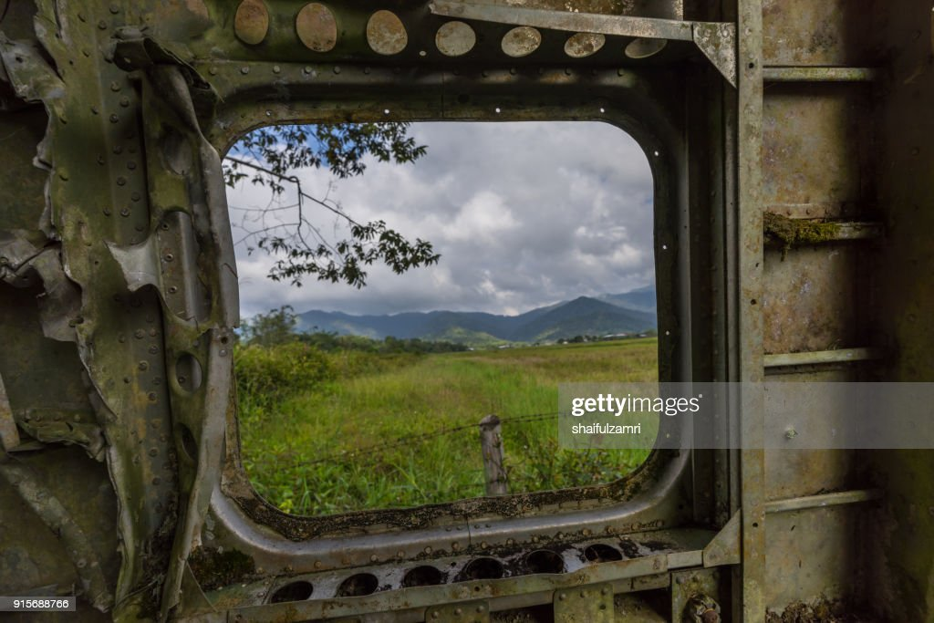 View of mountains in Bario from the Bario plane wreckage, which is located by a local home stay called Nancy Hariss Homestay. : Stock Photo