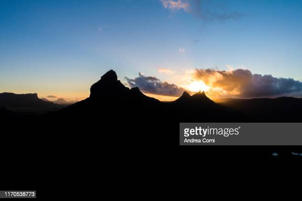 view of mountains in silhouette during sunrise - インド洋 ストックフォトと画像